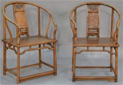 Pair of Chinese hardwood horseshoe back armchairs, each