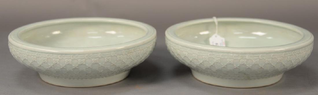 Pair of celadon glazed center bowls having basket weave