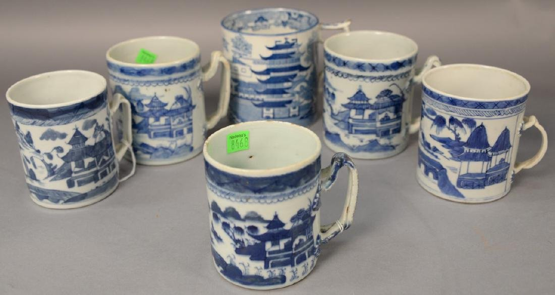 Group of six blue and white porcelain mugs in willow
