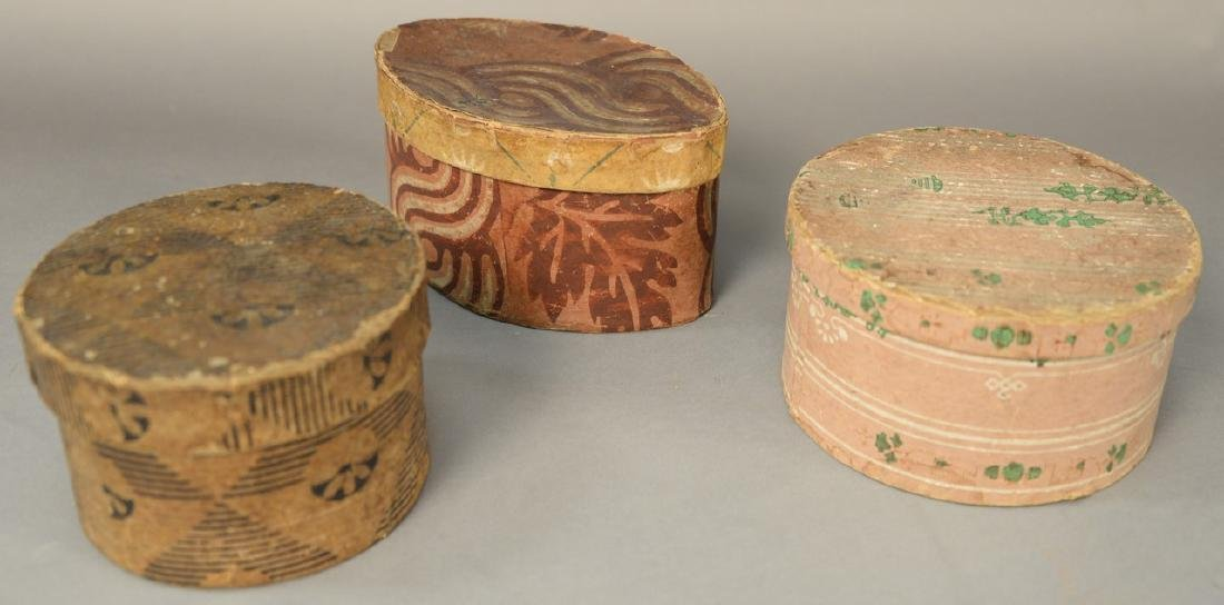 Three small wallpaper boxes including a small round