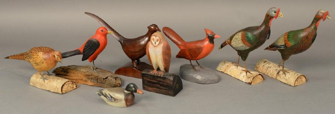 Group of eight miniature hand carved and painted bird