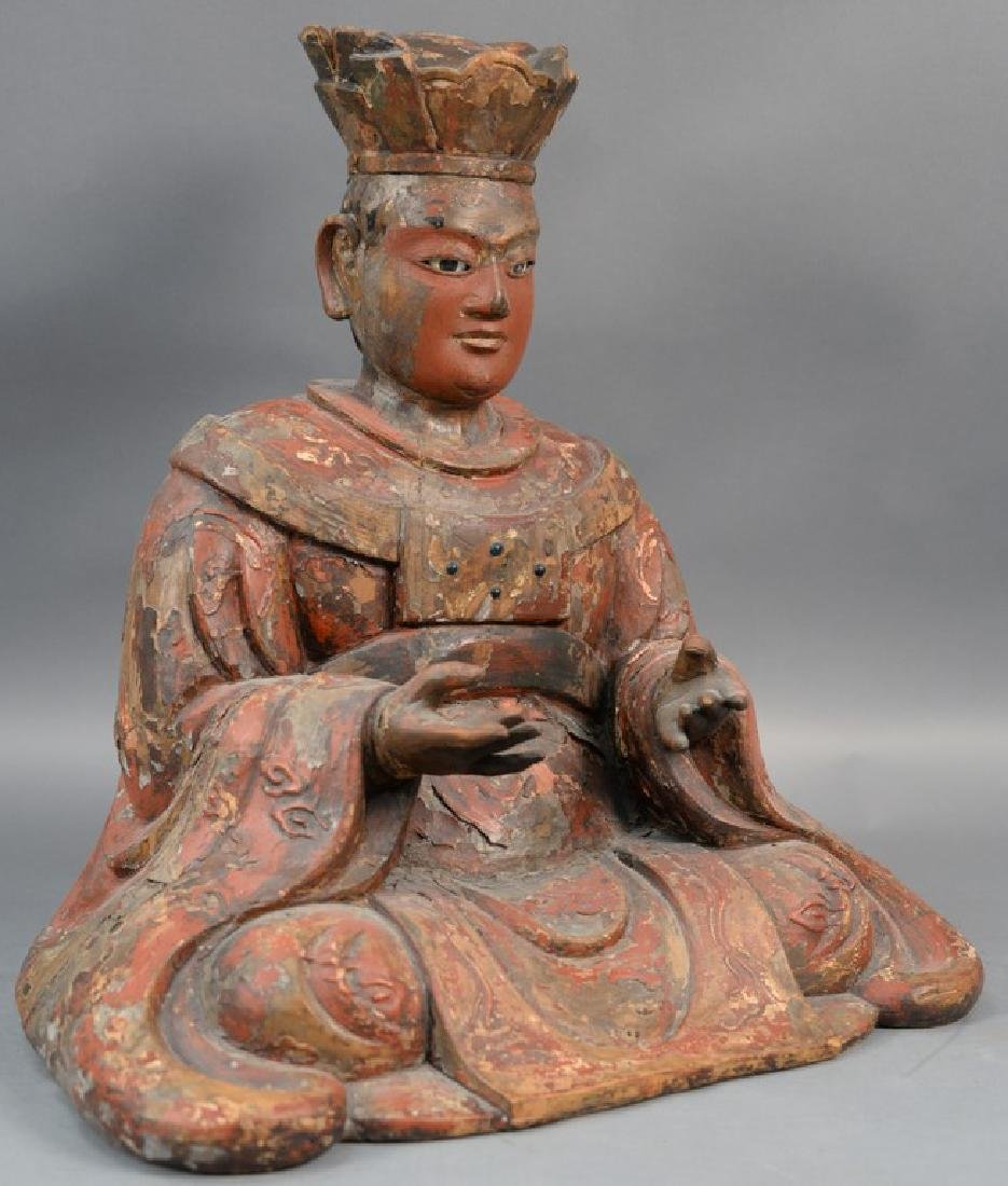 Large Chinese carved and red painted gesso seated