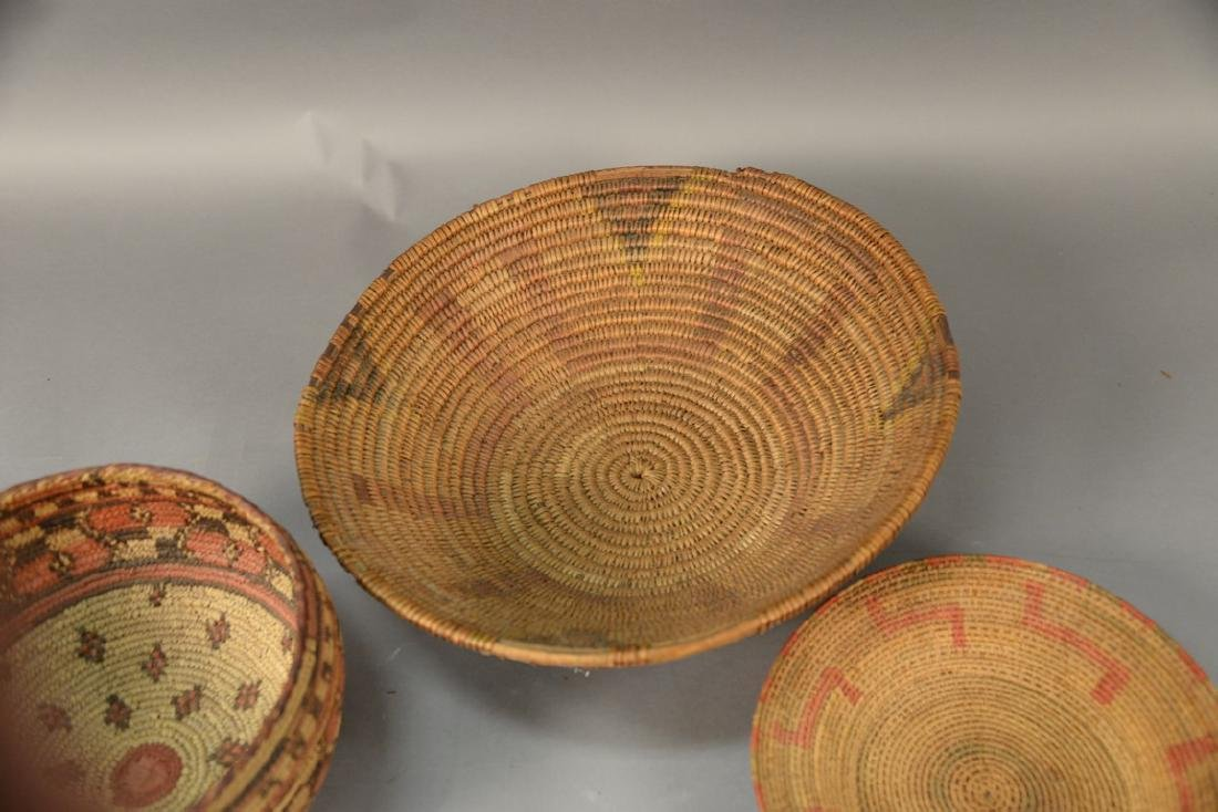 Three coiled Indian baskets, each with decoration. - 3