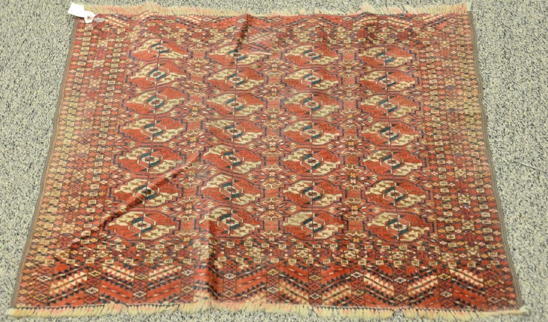 "Two Bokhara Oriental throw rugs (worn).  (4' x 5'4"") - 4"