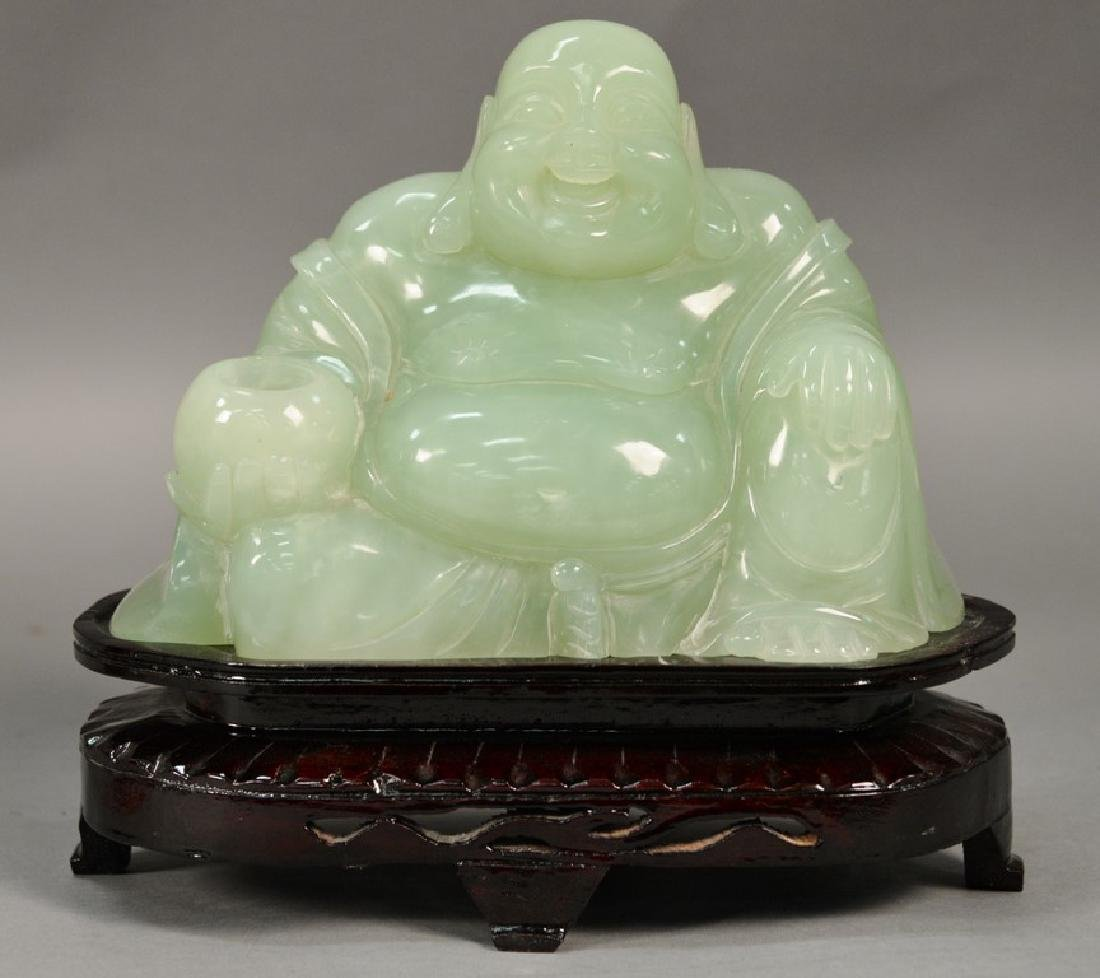 Large carved jade or jadeite figure of a seated buddha.