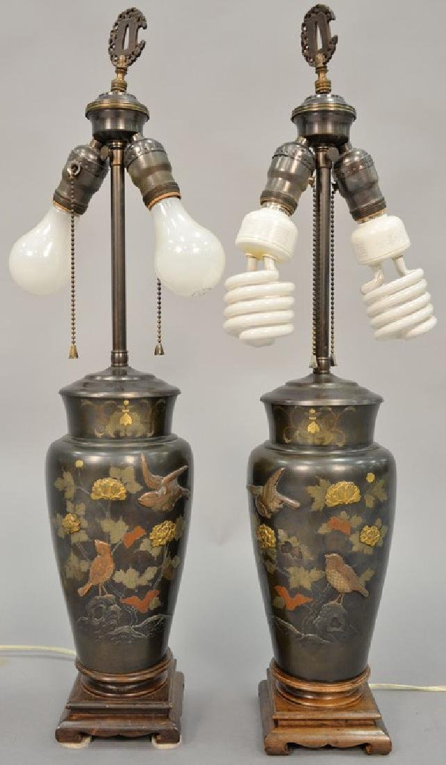 Pair of Japanese mixed metal baluster vases, decorated