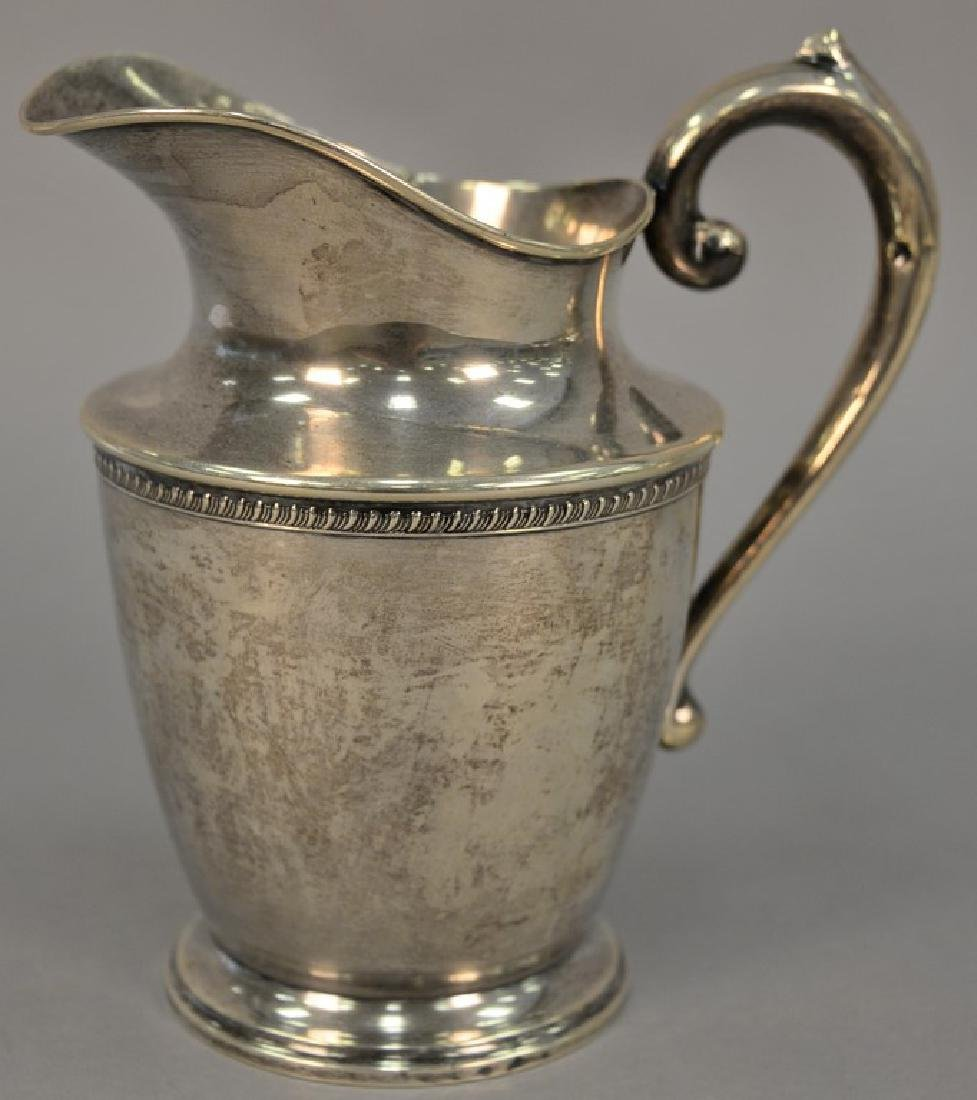 Sterling silver pitcher. ht. 8 3/4in., 19.64 t oz.