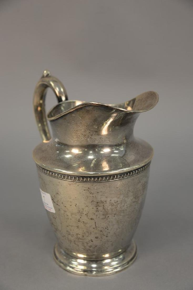 Sterling silver pitcher. ht. 8 3/4in., 19.64 t oz. - 2