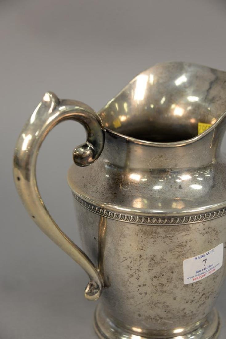 Sterling silver pitcher. ht. 8 3/4in., 19.64 t oz. - 3