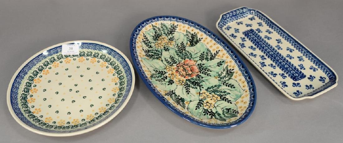 Twelve handmade Polish pottery pieces to include a set