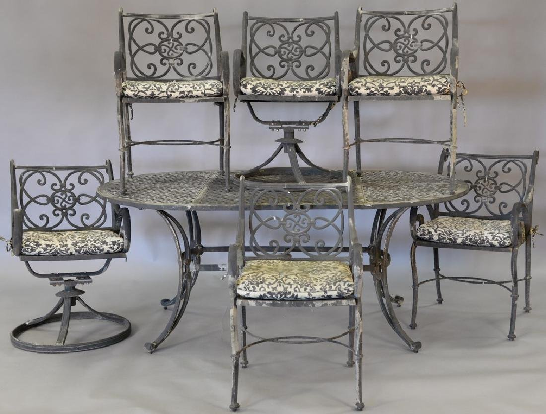 Seven piece metal outdoor set including table and six