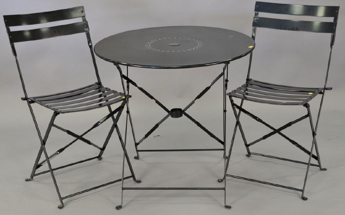 Small outdoor metal folding table and two chairs. ht.