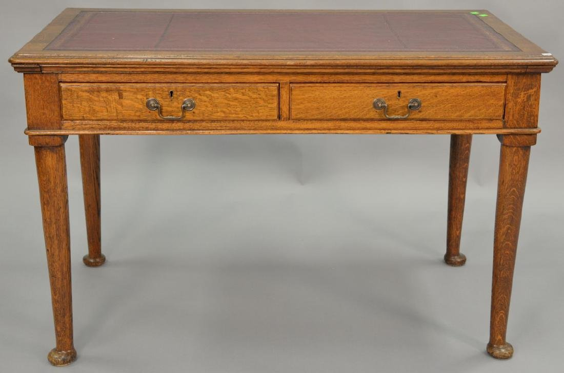 George IV oak writing table with inset leather top. ht.