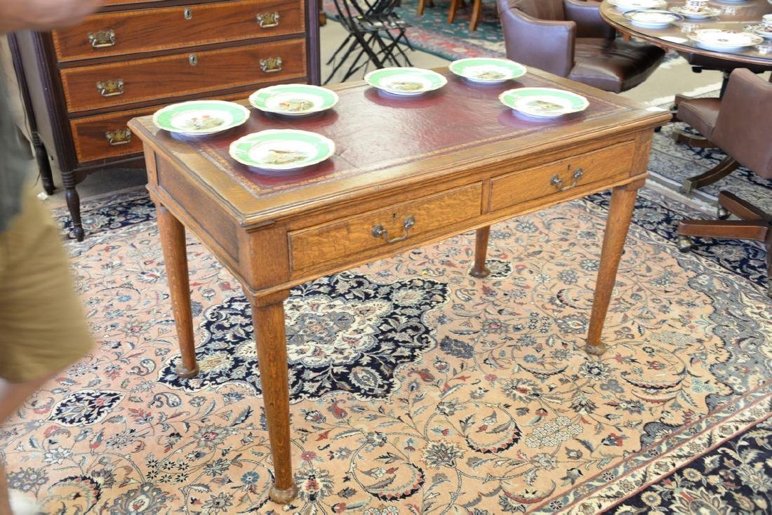 George IV oak writing table with inset leather top. ht. - 2