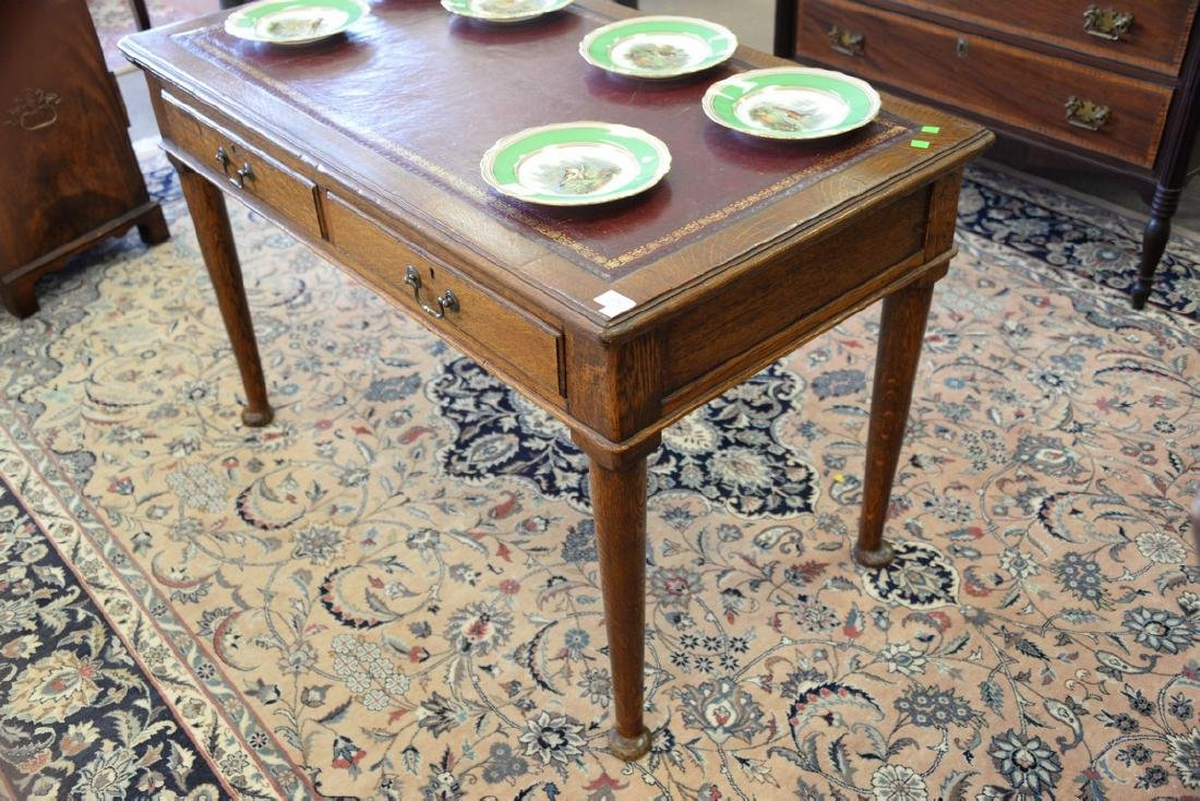George IV oak writing table with inset leather top. ht. - 4