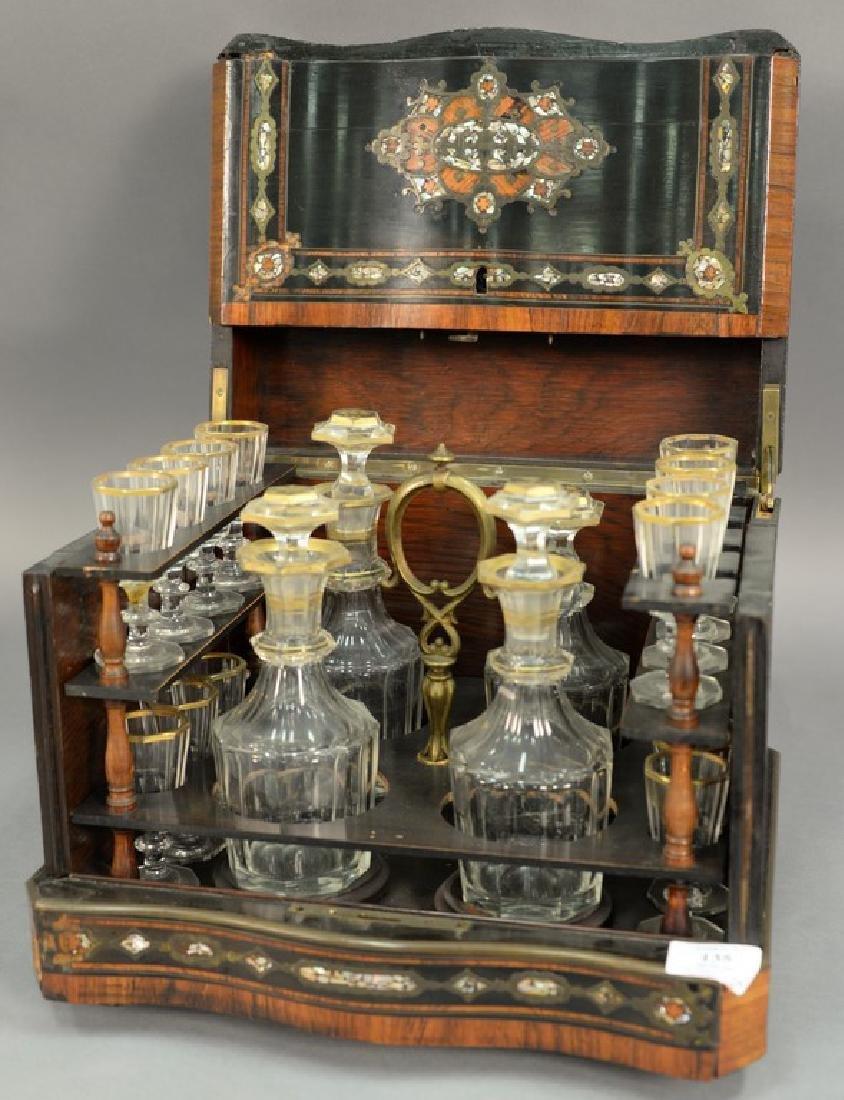 French inlaid tantalus, inlaid mahogany, ebonized wood,