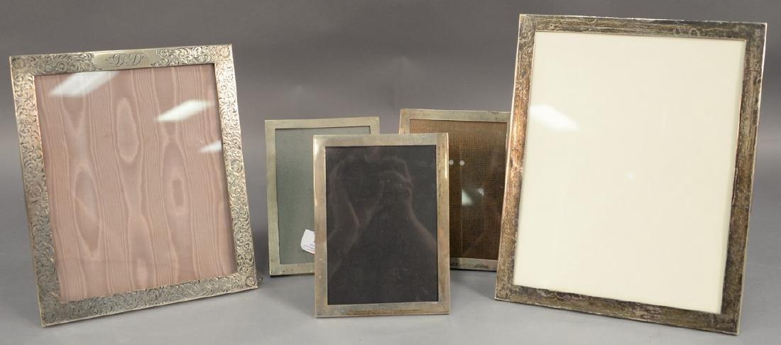 Five sterling silver picture frames including Shreve