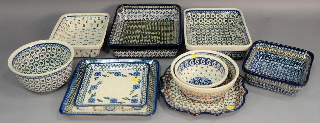 Ten handmade Polish pottery serving dishes including a