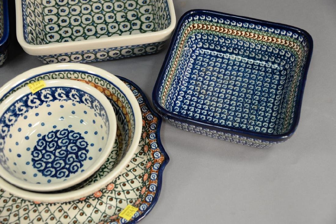 Ten handmade Polish pottery serving dishes including a - 2
