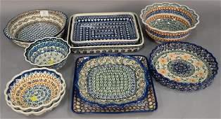 Ten handmade Polish pottery serving pieces including