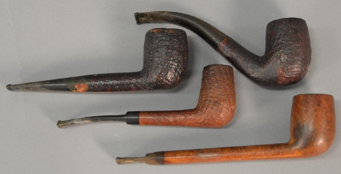 Four tobacco pipes including two Dunhill Shell Briar