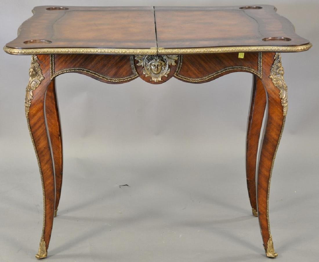 Louis XV style game table, opening to leather playing