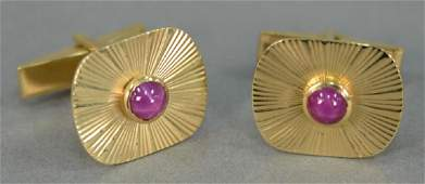 Pair of 14K gold cuff links mounted with star