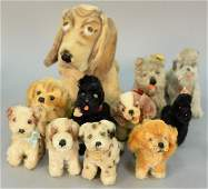 Group of eleven Steiff stuffed mohair dogs with movable