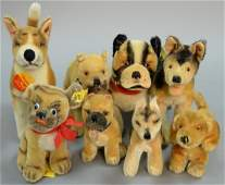 Group of eight Steiff stuffed mohair dogs to include