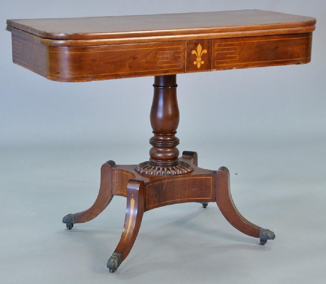 Federal mahogany game table having banded inlaid top,