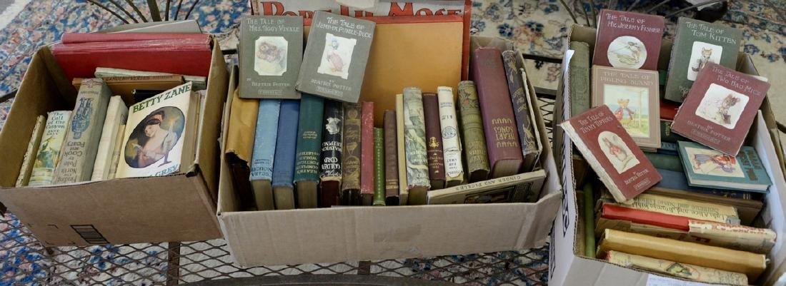 Three boxes of books to include nine Beatrix Potter