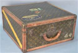 Louis Vuitton suitcase with interior tray, two labels