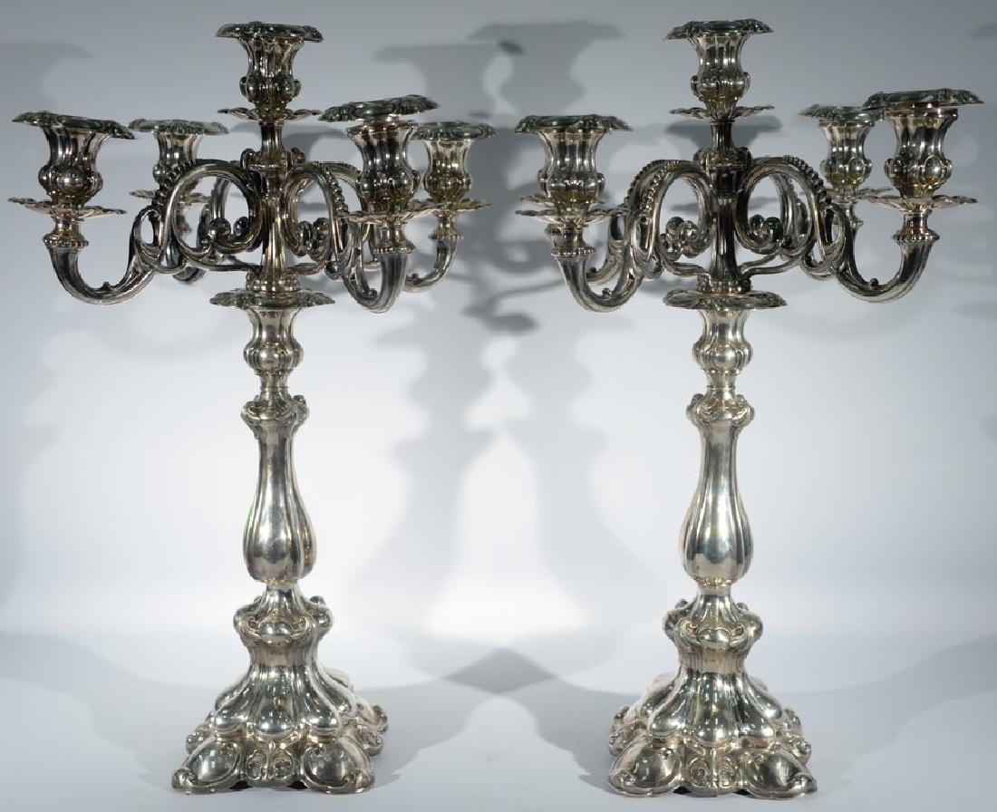 Pair of German silver five light candelabra