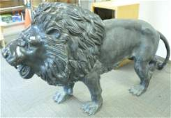 Pair bronze life size male lions with full manes (one