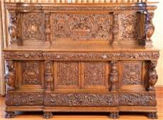 Oak sideboard having carved panel back with compote of