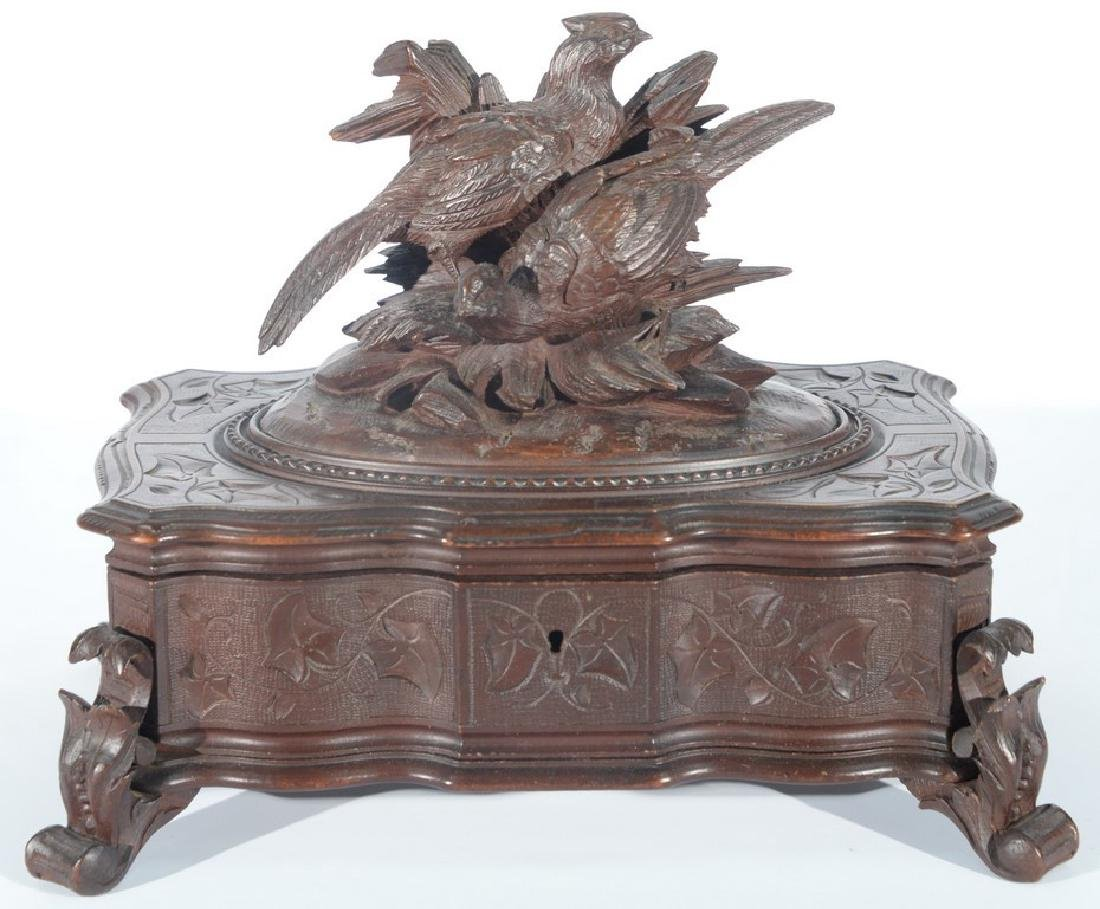 Black forest carved box topped with two game birds, set