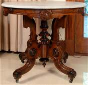Victorian walnut table with oval marble top. ht. 30in.,