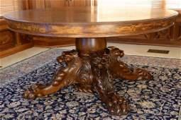 Victorian round oak table having center pedestal carved