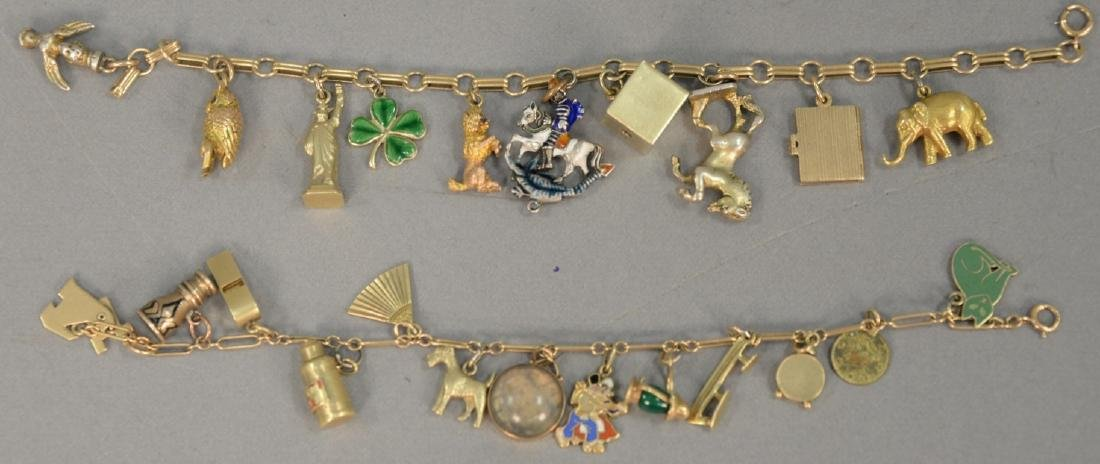 Two gold charm bracelets, each with several gold