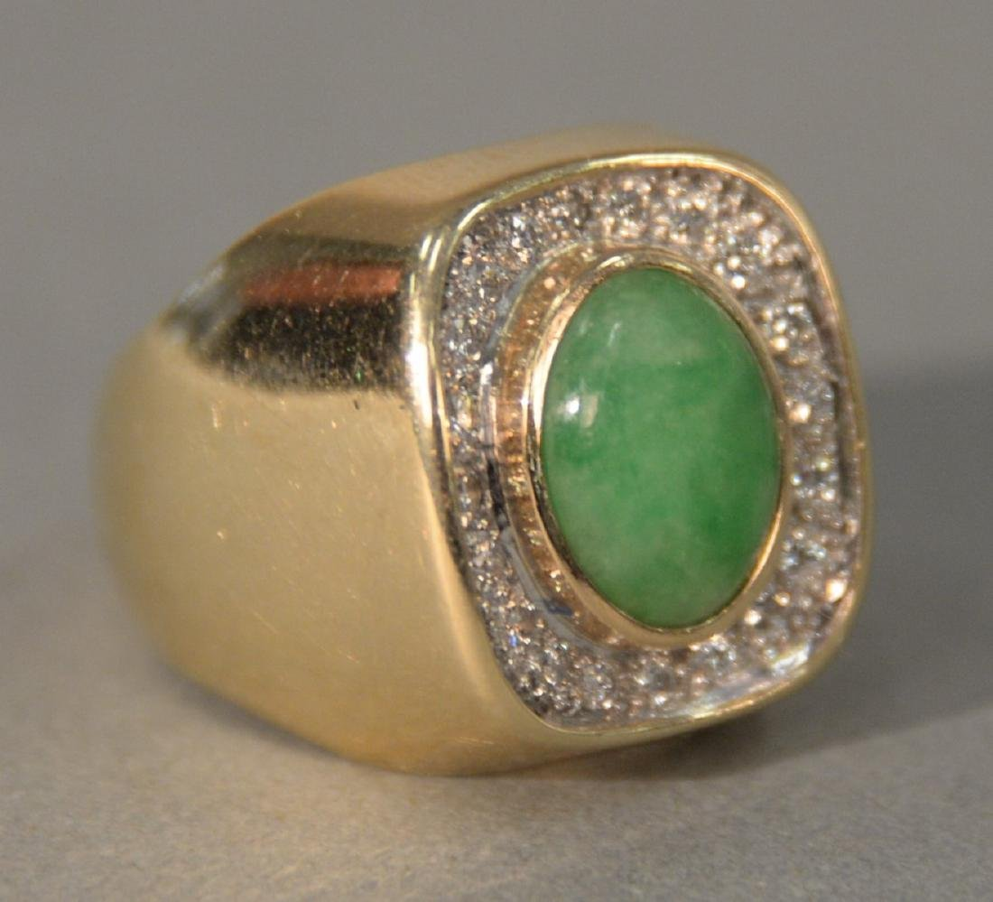 14 karat gold ring set with green jade surrounded by
