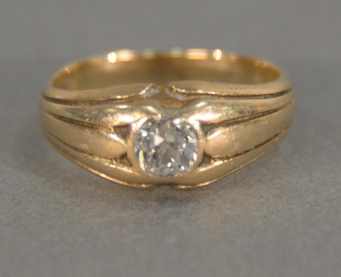 14K gold ring set with center diamond, approximately