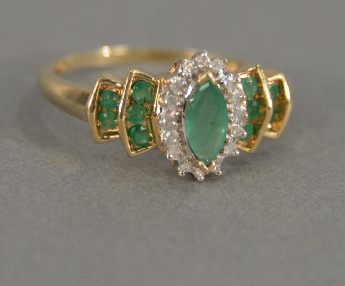Ladies 14 karat yellow gold emerald cluster ring