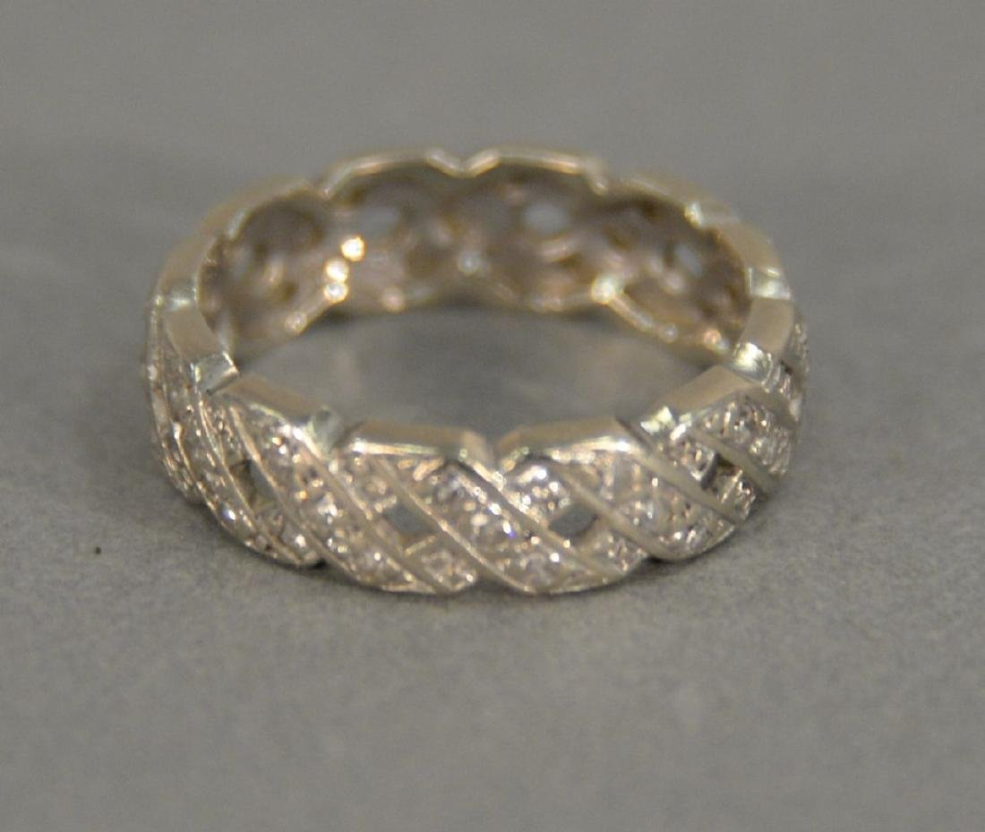 18K white gold band X band and diamond ring. 4.1 grams