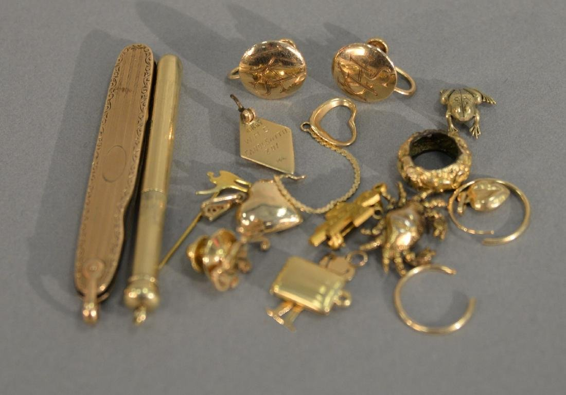 Gold lot to include kife, pencil, charms, buttons, etc.