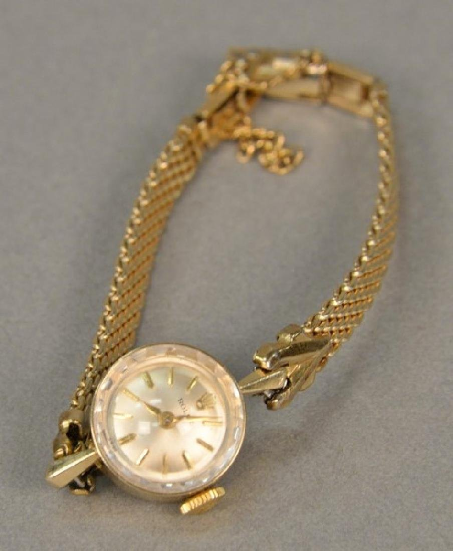 Rolex vintage ladies wristwatch in 14K gold case.