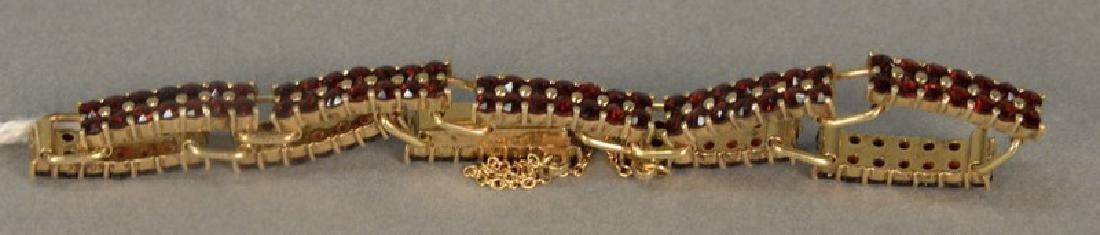 18K gold bracelet with ten rectangular sections, each