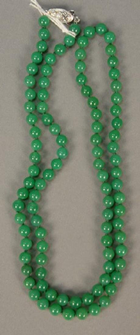String of hard stones with silver clasp. lg. 26 1/2in.