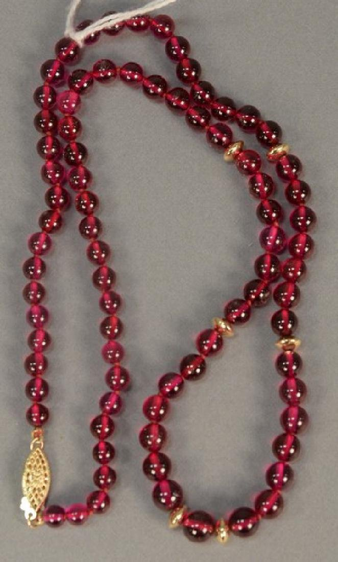 Cultured ruby and gold bead necklace. lg. 21in.