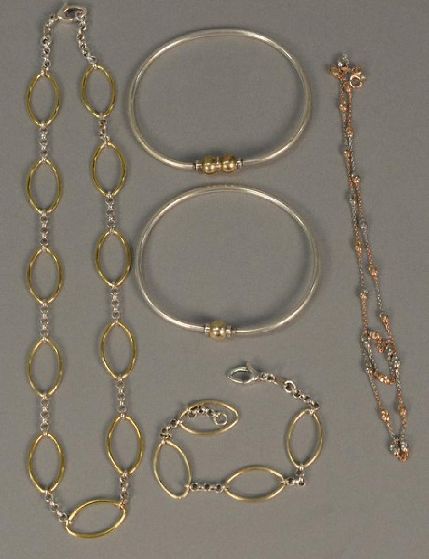 Five piece lot including two gold and silver necklaces,