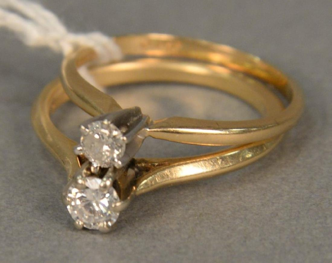 Two 14K and diamond engagement rings.
